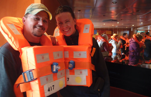 Jess and Kobus with lifejackets on at the safety drill.