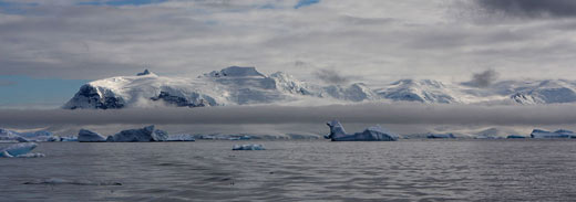 A view of icebergs and mountains in Antarctica.