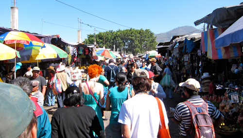 A crowded street through the market.
