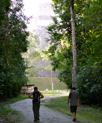 Jared and Kobus walk towards the ruins of Tikal.