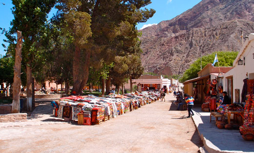 The central square of Purmamarca, lined with vendors selling textiles.