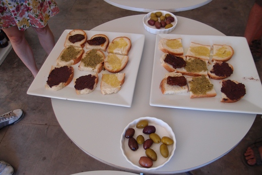 Olive tasing with bread, olive paste and dry tomatoes