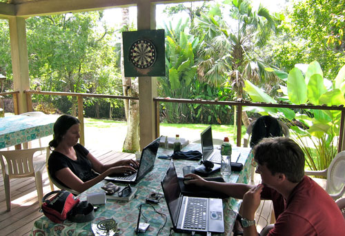 Jessica and Kobus with the laptops, working in the jungle.