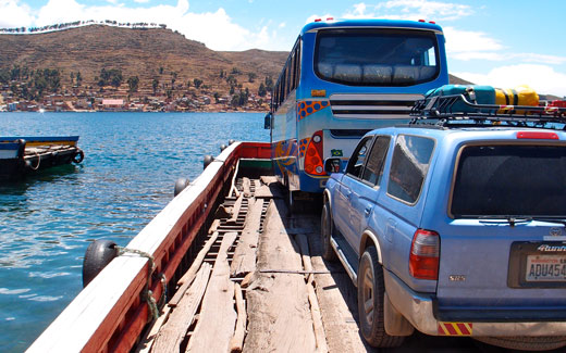 Blue sits on a barge crossing Lake Titicaca.