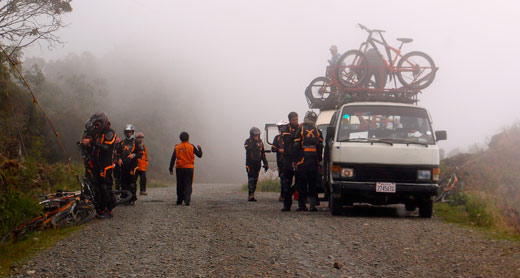 A group of bicyclists preparing to descend The Death Road.