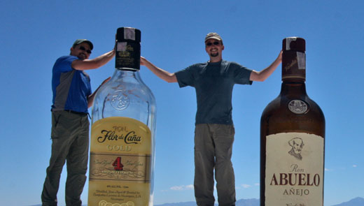 Jared and Kobus with two gigantic bottles of Rum.