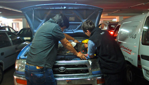 Mechanics fixing Blue's oil leak.