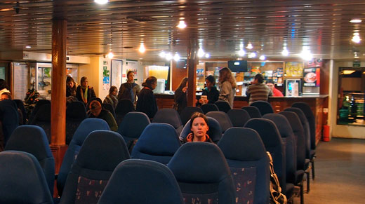 Jessica looking unhappy about the seating arrangement on the ferry.