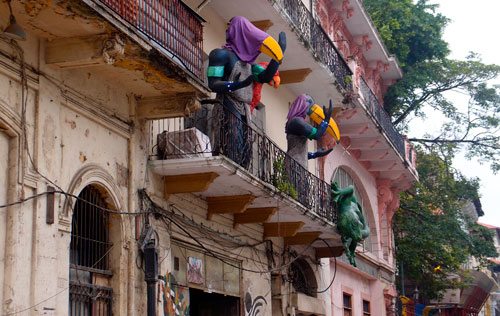Crazy toucan statues in front of a hostel.