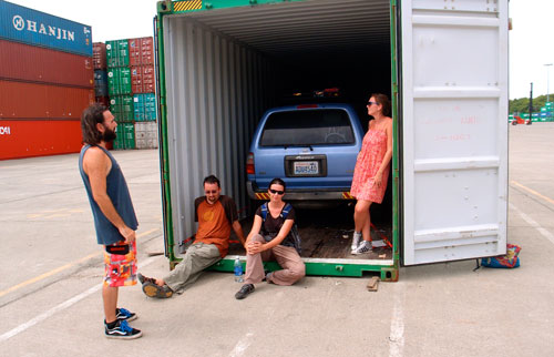 Waiting in front of the container.