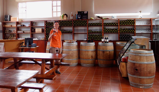 Jess samples some Colombian wine at a winery.