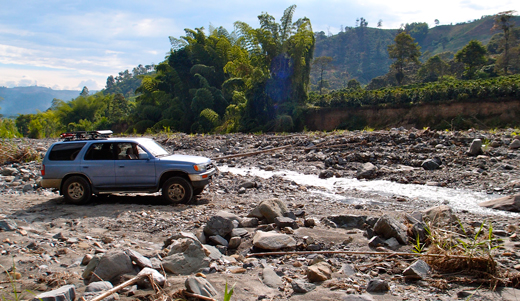 Blue drives through a river bed on our way to a coffee farm near Manizales.