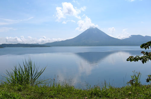 A beautiful shot of Volcan Arenal behind the lake.