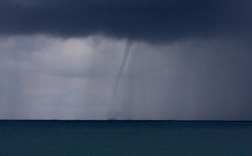 A water spout forms in the ocean in front of our campsite.