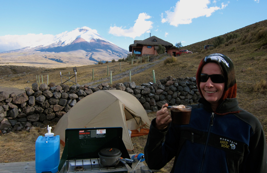 Jessica enjoys hot cocoa with marshmallows at our campsite below Volcan Cotopaxi.