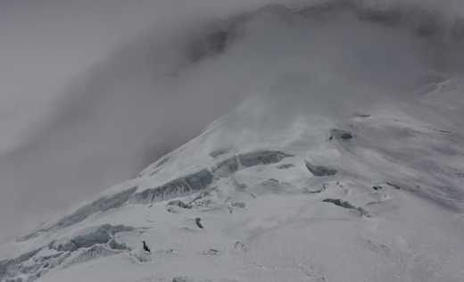 A closeup of the snow covered peak of Cotopaxi.
