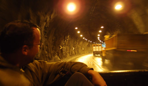 Riding in the back of a pickup through a tunnel on the way to Banos.