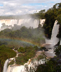 A view of Iguazu Falls with a rainbow.