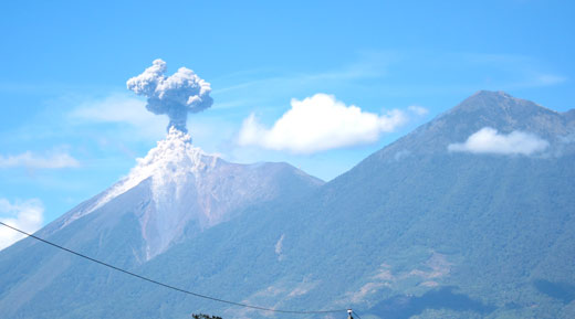 Volcan Fuego erupting as seen from the roof of our house.