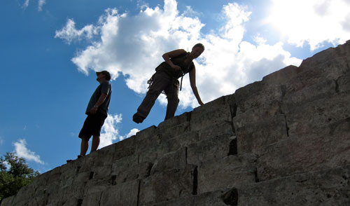 Jess and Kobus climbing through the ruins of Uxmal.
