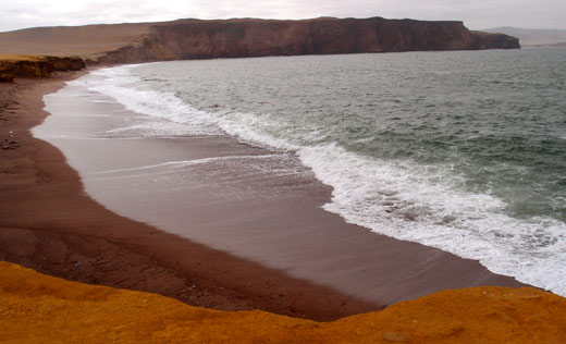The red beach a huge cliffs in Paracas Nature Reserve.