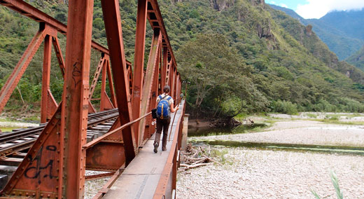 Crossing a rickety bridge along the hike to Aguas Calientes.