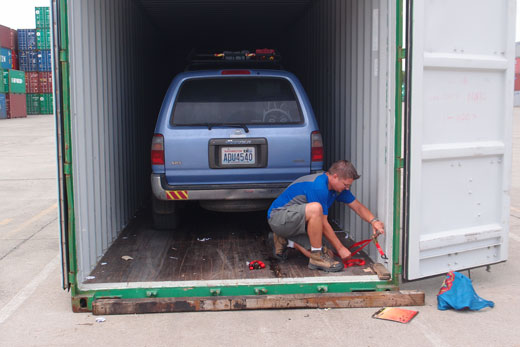 Tying down the car int the container to ship
