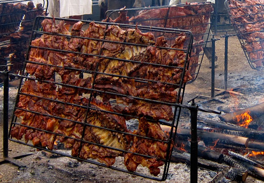 Giant racks of roasting pig at the Lima food festival.