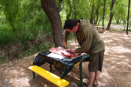 Prepping the pig on location at our new campsite.