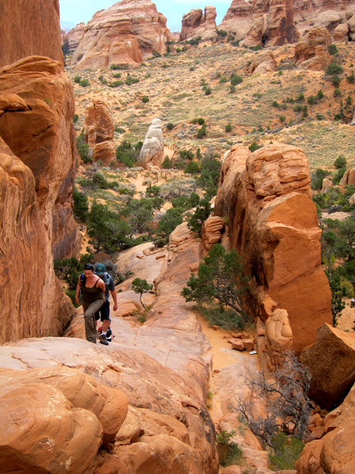 Jess and Kobus hiking in Arches National Park.
