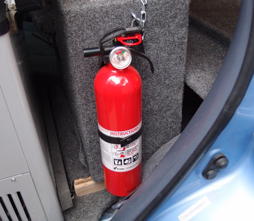 Fire extinguisher mounted on lock box.