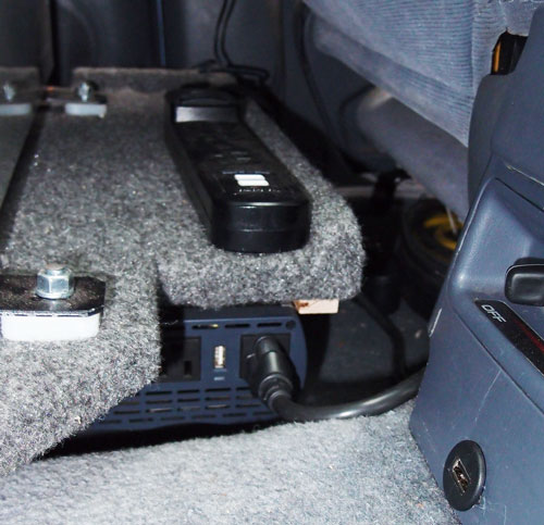 Power strip, inverter and USB plug mounted in the rear seat.
